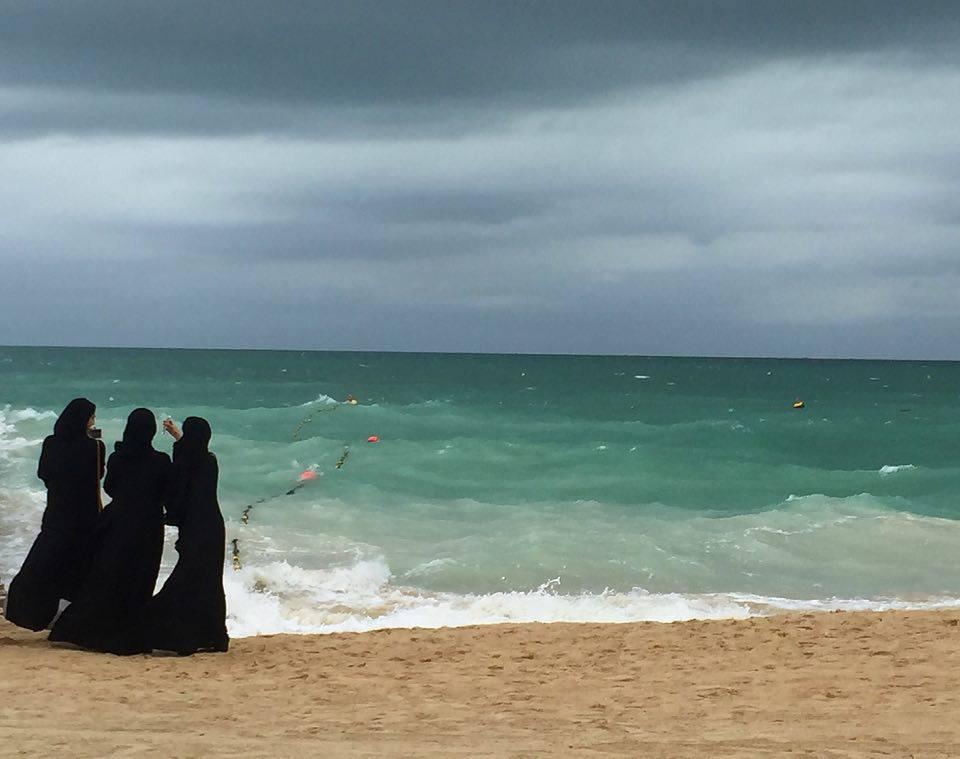 Local Emirati ladies capturing the rain in Dubai